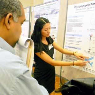 Student explaining research on poster