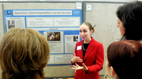 Student explaining research