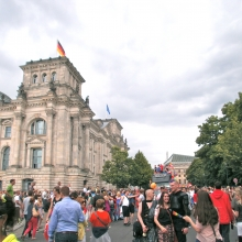 "Crowds gather near the ""Reichstag"" building at the end of CSD Berlin's parade"