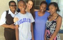 Sarah Sawyer with a family in Arusha, Tanzania!