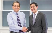 Interim Provost Forrest Maltzman congratulates Karim Farishta on the honor of being named a Truman Scholar